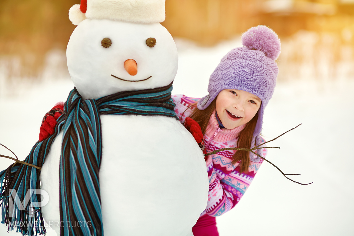 Young girl with snowman